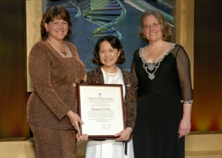 Margaret Wu (center) receives the 2007 Industrial Chemistry Award from ACS President Catherine Hunt (right) and the Division of Business Development and Management Chair Janet Bryant (left) at the ACS Spring National meeting.